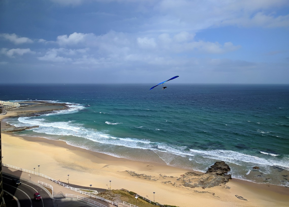 Hang glider over the Newcastle Beach