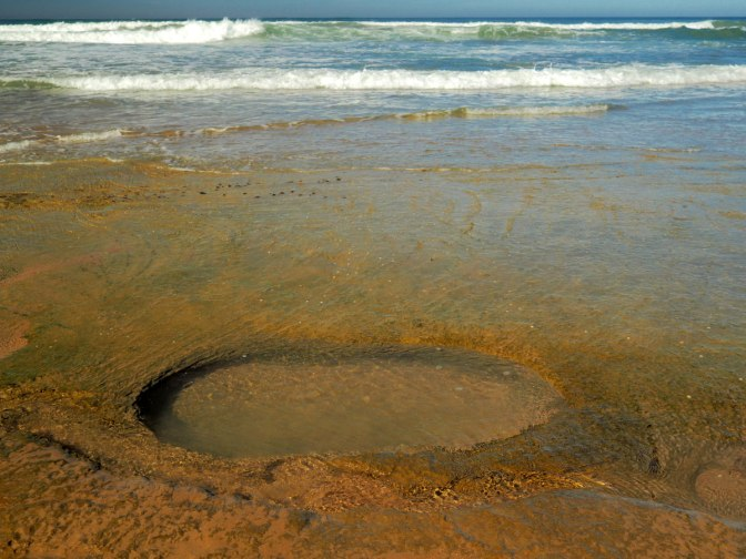 Water carved hole in the rocks