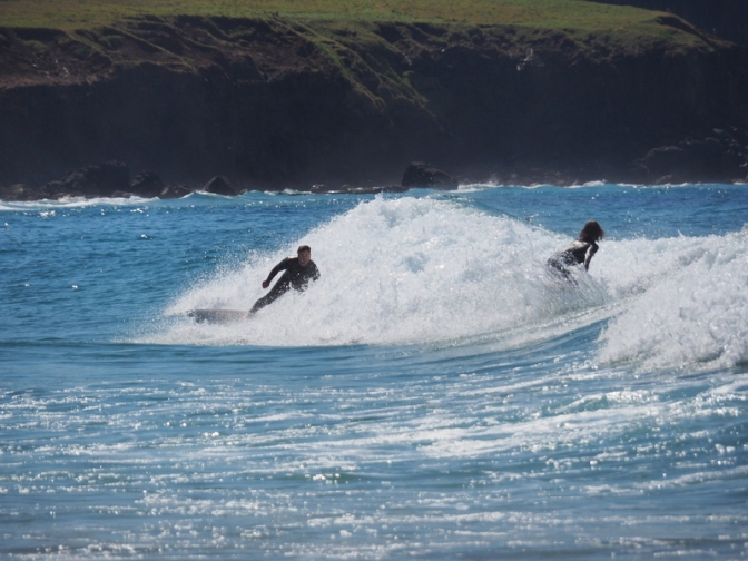 Surfers surfing in the surf