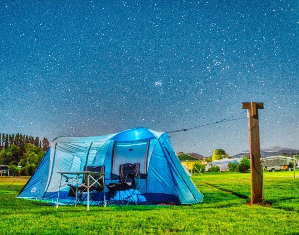 Classic glowing tent under a starry sky shot